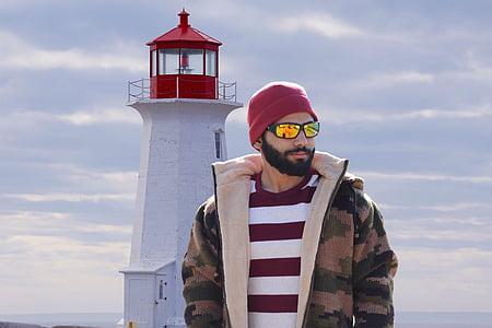 man standing near lighthouse