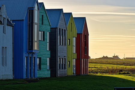 blue, green, gray, yellow, and red wooden houses