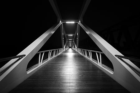 grayscale photo of suspension bridge