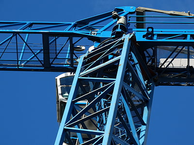 blue and white crane under blue sky during daytime