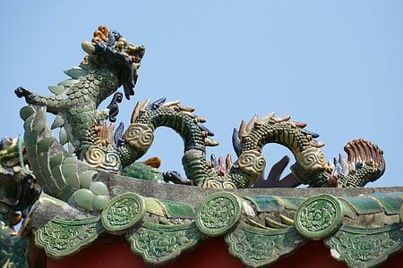 green concrete dragon statue