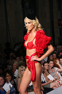 woman in red lingerie standing on runway