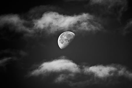 half moon on cloudy sky