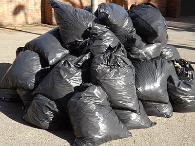 pile of black plastic bag lot