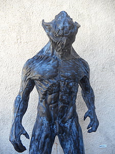 art photography of creature statue
