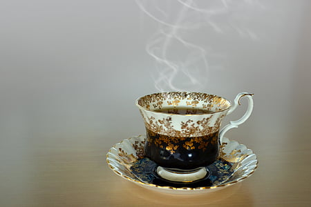 photography of white teacup filled with hot coffee