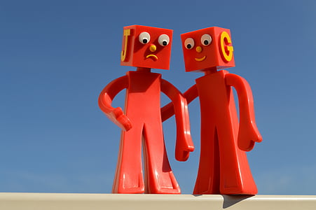 two red plastic cartoon characters