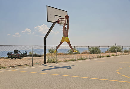 man dunking during daytime