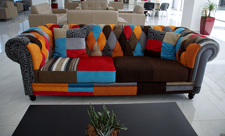 Photo Of Empty Tufted Gray And Multicolored Roll Arm Sofa