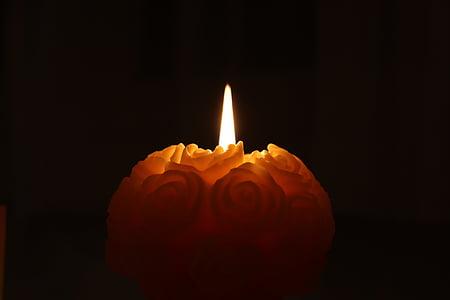 orange candle in the dark