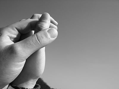 grayscale photography of holding hands