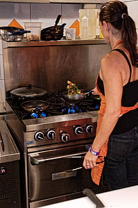 woman cooking on gray cooking pot