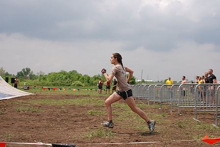 woman wering gray shirt and black shorts under cloudy sky during daytime