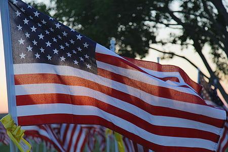 shallow focus photography of flag of USA hanged on pole