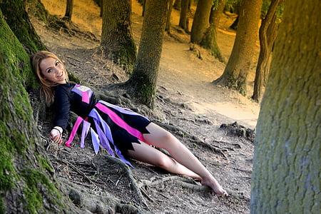 woman lying down on soil