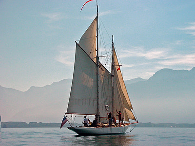 photo of white sailboat