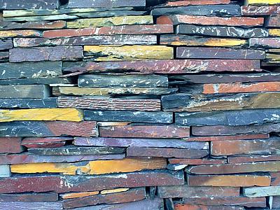 closeup photo of assorted-color of wall bricks