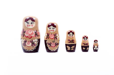 photo of five staggered height matriyoshka figurines