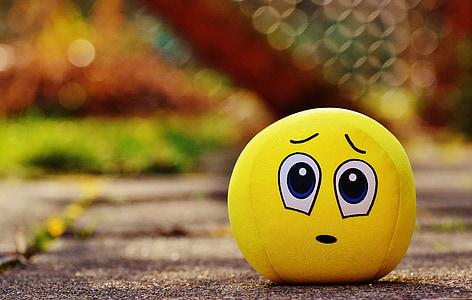 closeup photo of yellow emoji plush toy