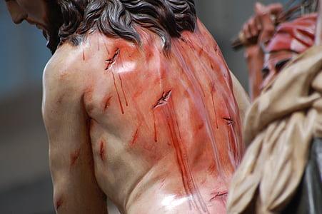 close-up photo of Jesus Christ figurine
