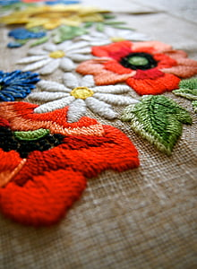 shallow focus photography of assorted-color floral embroidered textile
