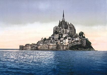 concrete castle near body of water