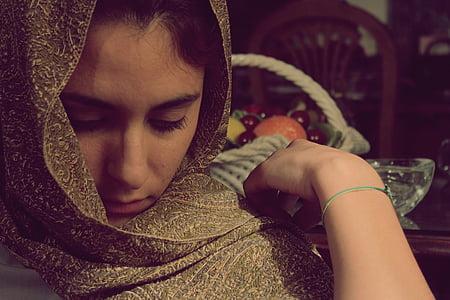 woman wearing brown hijab headdress
