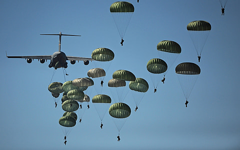 photo of people doing parachutes on sky at daytime