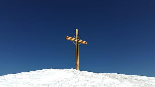 brown cross on snowfield