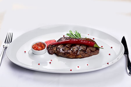 grilled food served on white plate