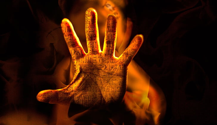 left human hand with hieroglyphs