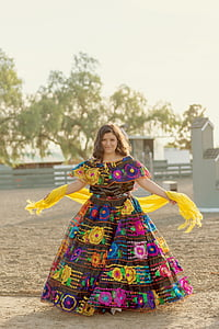 woman wearing multicolored dress standing