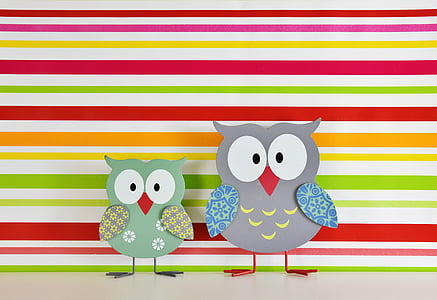 two assorted-color bird wooden decor