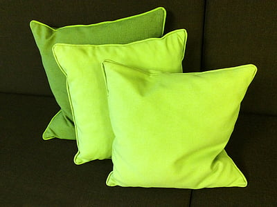 three green throw pillows