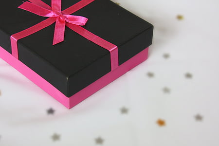 closeup photo of black and pink box with bow accent