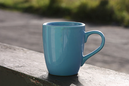 close up photography of green ceramic mug during day time