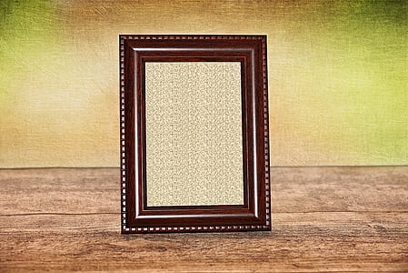 black photo frame on top of brown wood