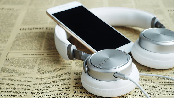 Royalty Free Photo Shallow Focus Photography Of Gold Iphone 6 And White Wired On Ear Headphones On Yellow Newspaper Pickpik