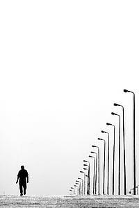 man waling on the street during daytime