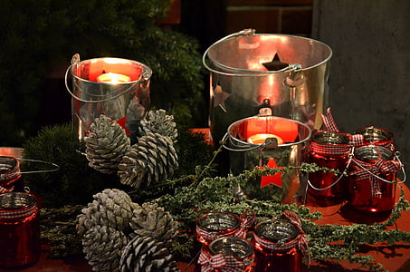 candles in silver buckets