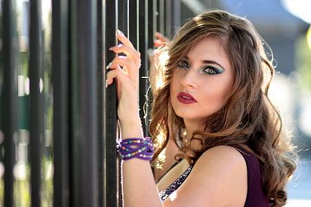 portrait photography of woman in purple multi-strand bracelet