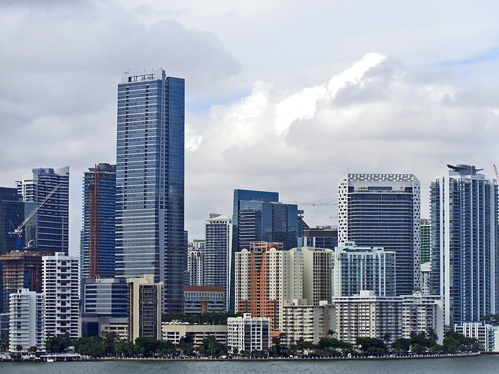 assorted buildings near body of water