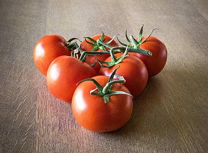 six orange tomatoes