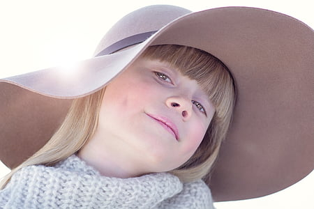 girl wearing gray sun hat