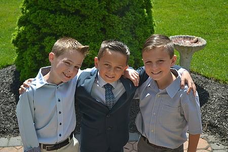 three boys taking a groupie