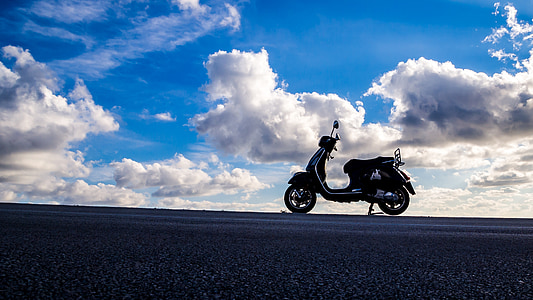rule of thirds photography of black motorcycle