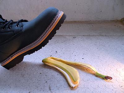 black leather work boot near yellow banana