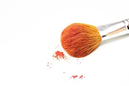orange makeup brush