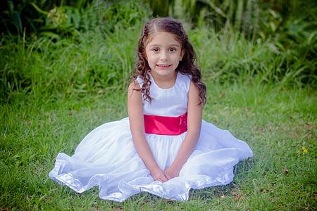 girl wearing white sleeveless dress