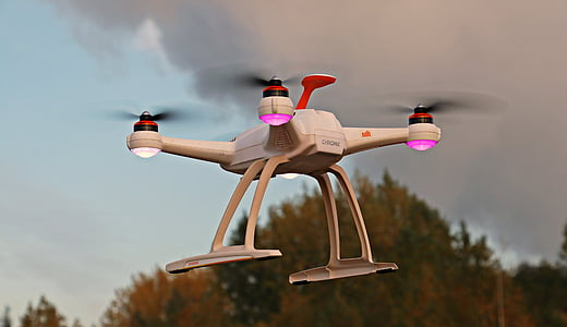 white quad copter drone